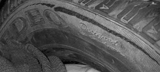 Вид на кольцевой излом боковой стенки покрышки по фото 5 при деформации боковой стенки